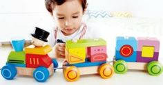 50% off select Hape Toys = Train Stacking Block Pull Along Only $12!