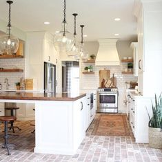 brick flooring Make a subtle statement with your lighting styledbysorrells does it beautifully with our Flynn Oversized Recycled Glass Pendants Tag potterybarn to share your style with us! Modern Farmhouse Kitchens, Farmhouse Kitchen Decor, Home Decor Kitchen, New Kitchen, Cool Kitchens, Kitchen Ideas, Awesome Kitchen, Farmhouse Flooring, Farmhouse Style