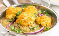<p>In this recipe, cauliflower florets are seasoned with a mixture of turmeric and salt, and then roasted until golden and tender. A dry masala mix is then cooked in an aromatic tomato curry, with an additional layer of spices added in. </p>