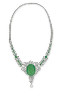 AN ART DECO EMERALD AND DIAMOND NECKLACE - Centering upon an oval emerald intaglio depicting a woman's face, within a pierced old European and single-cut diamond scalloped plaque, to the tapered old European and single-cut diamond band, set with a line of calibré-cut emeralds, with two square-cut emerald accents, to the platinum backchain, circa 1925