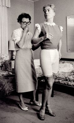 JOAN CRAWFORD dress fitting Hollywood 1959 photo (detail) by EVE ARNOLD (with a very interesting chapter on Joan) from Eve Arnold in Retrospect 1995 1st edition (please follow minkshmink on pinterest) #joancrawford #evearnold #girdle #fifties