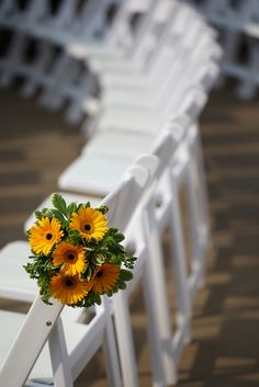 Outdoor pew decoration by William's Florist