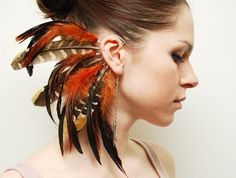 Feather Ear Cuff  Fire Tiger by Njuu on Etsy, $31.00 for years I have ogled these ear cuffs but never been brave enough to try and pull it off