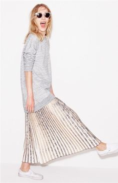 An Oversize sweater and Metallic Skirt from J.Crew: (http://racked.com/archives/2014/08/18/jcrew-september-style-guide.php)