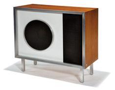 1956 Charles & Ray Eames Cabinet with Tru-Sonic Speaker   Enameled metal, brushed aluminum, Saran plastic, walnut Stephens Tru-sonic, Inc. Retains Tru-Sonic Inc. label and medallion