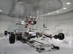 Deconstructed: Mercedes' 2010 Formula 1 car - seen here in all its glory - is stripped down and suspended on wire at the exhibition in Weybridge, Surrey