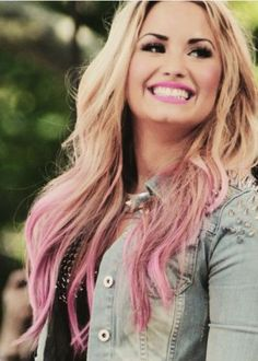 Her hair is just like mine, pink ends and blond hair, except mines really curly