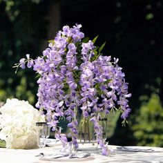 The selection of flowers takes an important place for event decoration arrangements. It is amazing how something as simple as flowers can drastically enhance the look of your event. Make your wedding outstanding with our beautiful collection of flowers Diy Wedding Flowers, Garland Wedding, Wedding Flower Arrangements, Floral Centerpieces, Wedding Centerpieces, Floral Wedding, Wisteria Wedding, Wedding Decorations, Purple Wedding