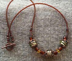 Bumblebee Striped Bead Necklace by goosecrossingfarm, $18.00  https://www.etsy.com/listing/181653638/bumblebee-striped-bead-necklace-glass?ref=listing-shop-header-0