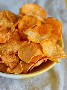 These healthy homemade sweet potato chips are just as crunchy and addictive as the real-deal. Made with only three simple ingredients, they make it easy to increase your vegetable intake while satisfying your craving for chips. #healthysnack #homemadechips