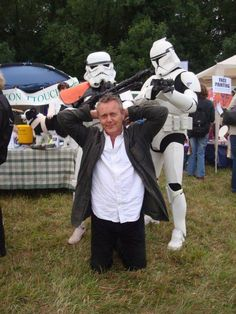 """Anthony Stewart Head being """"arrested"""" by Stormtroopers."""
