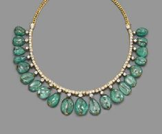 IMPORTANT JEWELLERY 6 December 2006 London, King Street.  AN ANTIQUE EMERALD AND DIAMOND FRINGE NECKLACE  Composed of twenty graduated drilled emerald beads to an old-cut diamond collet surmount and line necklace with curb-link back section, late 19th century, 38.0 cm. long. $16,556 Estimate $11,826 - $15,768