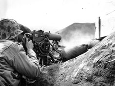 An U.S Marine fires a Browning M1917 machine gun at Japanese positions on Iwo Jima, February 1945. #WW2