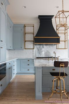 Inside our 1905 Historic Home Restoration...  classic-vintage-modern-kitchen-blue-gray-cabinets-inset-shaker-black-gold-vent-hood-antique-brass-faucet-white-subway-backsplash-tile-gold-open-shelves