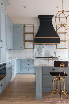 classic-vintage-modern-kitchen-blue-gray-cabinets-inset-shaker-black-gold-vent-hood-antique-brass-faucet-white-subway-backsplash-tile-gold-open-shelves-8-of-18