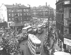 The last tram procession through Bridgeton Cross on 4th September, 1962. Many people created their own souvenirs of the occasion by placing pennies on the lines for the trams to run over.