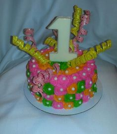 Smash cake of color.  Pink orange green yellow 1st birthday