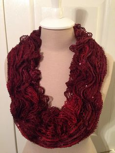 "Ruffled Cowl scarf using round loom and Red Heart Sashay sequin ""Cabernet "" yarn"