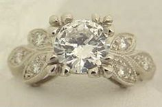 Vintage inspired engagement ring with leaf motif