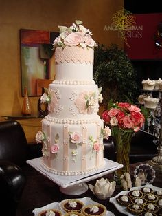 roses, pearls, and lace wedding cake
