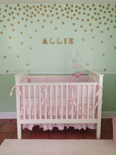 Love these falling gold wall decals in this sweet mint green nursery!