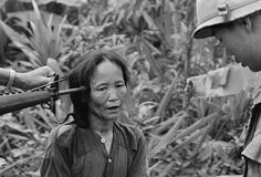 A female Viet Cong suspect is questioned by a South Vietnamese police officer, as a U. soldier holds a rifle to her temple in Tam Ky, Vietnam, November 1967 Vietnam History, Vietnam War Photos, National Police, North Vietnam, War Photography, American Soldiers, History Museum, Photojournalism, Old Pictures