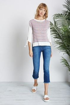 Round neck jumper with three quarter length sleeves. Cream background with a Navy,Red and Camel stripe. Sleeves have a tie feature at cuff. Size :True to size.