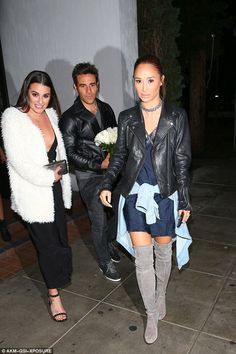Happy evening: The two actresses left the West Hollywood hot spot with a male friend who was carrying white roses