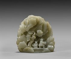 """Finely carved, Chinese celadon jade mountain; the flattened stepped rockery form depicting a sage on horseback, trailed by an attendant and beneath a pine tree; the verso with a goat; H: 3"""""""