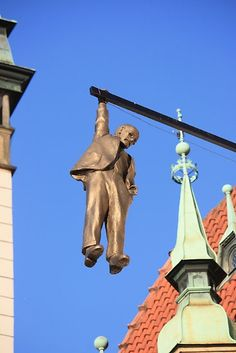 The Hanging Man at Olomouc in Prague by Indrani Ghose - hang in there! Statues, Prague Czech Republic, Pub Signs, Medieval Town, Store Signs, Sculpture, Installation Art, Budapest, Signage