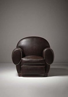 "emile – jacques ruhlmann, rare ""elephant"" chair, ca. 1926. {many art-deco-style club chairs are described as 'in the style of ruhlmann' because of similarities to this chair, especially the rounded back}"