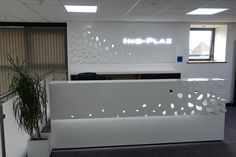 A Reception Desk fit for our new look office.  As part of our office refurbishment and to showcase continued developments with HI-MACS we created this bespoke Reception Desk. Incorporating Fret cut and engraving details in the main desk and the same fret cut design and LED illumination in the wall panel.