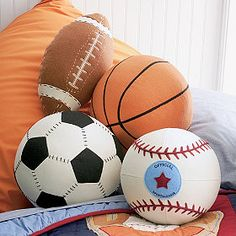 6) America's Passtime. Not just baseball any more. Pick a sport. And for the couch potato in us, these are Sports Ball Pillows...its a must!!