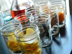 DIY Essential Oils for Energy, Aphrodisiac and More. Fill your mason jars to the brim with the corresponding booze. Vanilla & cinnamon get the brandy, the citruses get the vodka. Screw the lid on tight. Homemade Essential Oils, Making Essential Oils, Essential Oil Uses, Making Oils, Herbal Tinctures, Herbalism, Herbal Remedies, Natural Remedies, Oils For Energy
