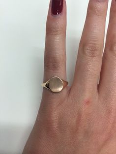 Ladies signet ring in 14kt rose gold measuring in 10.0x8.1mm. This signet ring shaped like an oval is perfect for a single initial but can also fit three initials. This signet ring in 14kt yellow rose features an open back and weighs approximately 1.5 grams. For three initials, please enter them in the exact order for engraving in the comment section. Please also specify if you would like the initials interlocking or evenly spaced. Engraving is done by a computer and does make it a final…