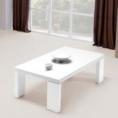 Buy perfect piece of #furniture for your home with glass top #coffeetable. It has strong white high #gloss legs constructed with finest material to add robustness in the table.