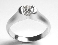 Suspension engagement ring in platinum with satin finish and .52ct diamond. DVVS Fine Jewelry