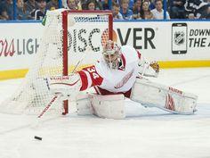 Detroit goalie Petr Mrazek pokes the puck away from