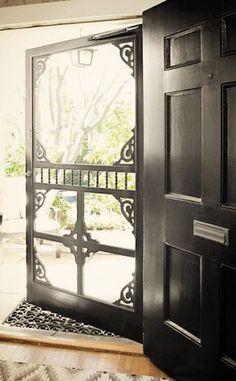 Black door and screen door. Farmhouse style