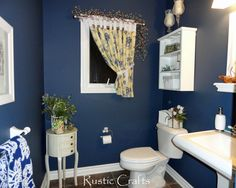 I decorated my small powder room in a dark navy for some extra drama and contrasted it with white.