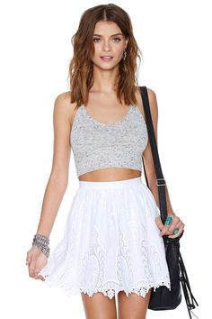 White is the color of the season and this skater skirt is the perfect way to stay on trend! It features embroidered detailing and a scalloped hem.