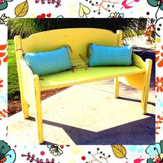 Adorable yellow bench made from an old bed frame.