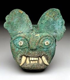 Moche culture of Peru, Ornament in the form of a feline face, c.100-450 (source).