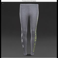 """NIKE  sports leggings/running/excercise pants size small  figure hugging track & field tights mixes jersey and spandex fabric for a stretchy and flattering fit  Grey with white hazard stripes and in flo yellow/green ICONIC """"NIKE TRACK/FIELD"""" logo on  leg these tights will make you stand out on the streets❗️will post on Ⓜ️ for less upon request Nike Pants Track Pants & Joggers"""