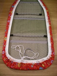 Ironing Board Cover Tutorial - I've done this before, w/o instructions, so it IS easy.  Now I can have a pretty board cover... maybe match to the sewing room curtains, or chair cushion, or sewing machine cover?