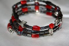 Lariat style necklace/bracelet made with hematite, red and silver accent beads, with adorable butterflies!