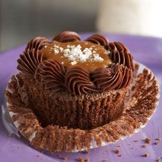 Boozy Baking: Bourbon adds its delicious smokiness to these Salted Caramel-Chocolate-Bourbon Cupcakes. More cupcakes: http://www.bhg.com/recipes/desserts/cupcakes/our-best-cupcake-recipes/