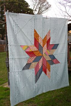 I really like the sorta polka-dotty, sorta not background used here (quilt by BeaSpoke Quilts).