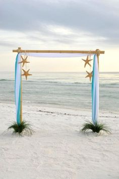 Beach Wedding Photos - [tps_header]One of the main decor elements for an outdoor wedding is an arch, and it's very important for a beach affair as your arch not only highlights the style but also set off the ocean behind. A beach wedding ar. Beach Wedding Arbors, Beach Wedding Reception, Beach Wedding Decorations, Wedding Venues, Wedding Arches, Wedding Ideas, Wedding Ceremony, Diy Wedding, Seashell Wedding