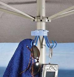 Umbrella Hook for Towels/Camera/Bags Sand Anchor http://www.amazon.com/dp/B000S3AKP4/ref=cm_sw_r_pi_dp_zT-Xtb03PVC4B6FB